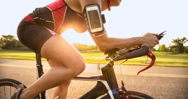 Cyclist listening music on smart phone