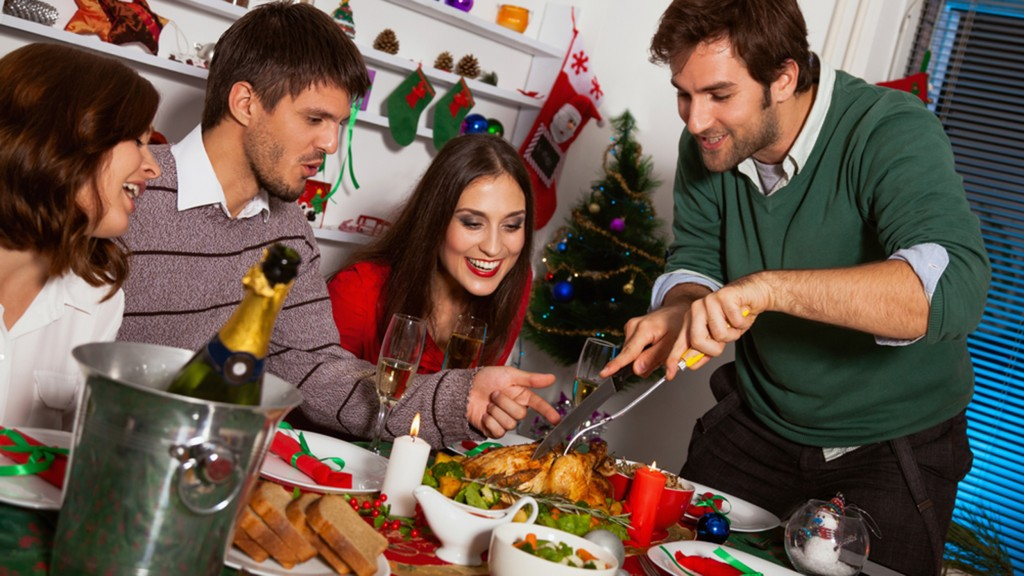 Young people gather together for Christmas dinner.; Shutterstock ID 160846937; PO: today.com